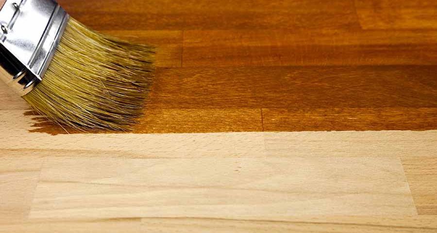 brush applying finish to a piece of furniture | Kuebler Furniture Works